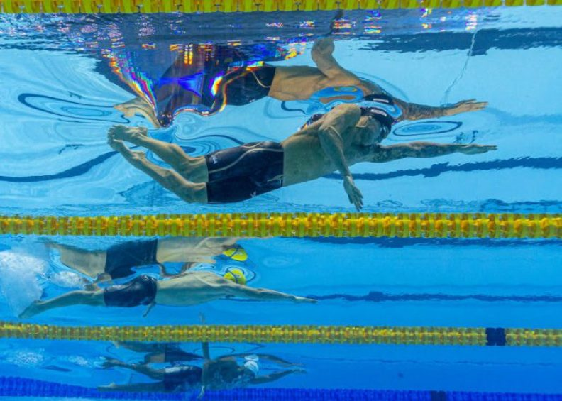 (From top) Winner Caeleb Dressel of the United States of America (USA), second placed Kyle Chalmers of Australia and third placed Vladislav Grinev of Russia compete in the men's 100m Freestyle Final during the Swimming events at the Gwangju 2019 FINA World Championships, Gwangju, South Korea, 25 July 2019.
