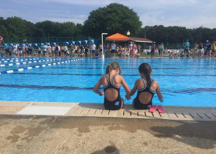 girls-sitting-by-pool