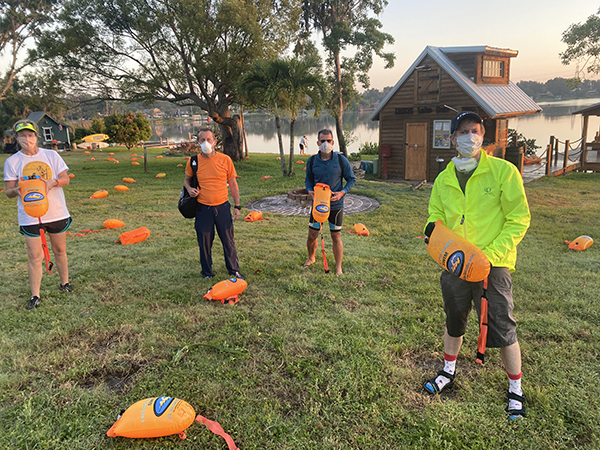 4 Volunteers spread out buoys before the swim