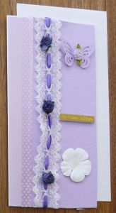 Purple birthday card with raised lace and flower details.