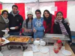 Smiling, happy ladies serving food