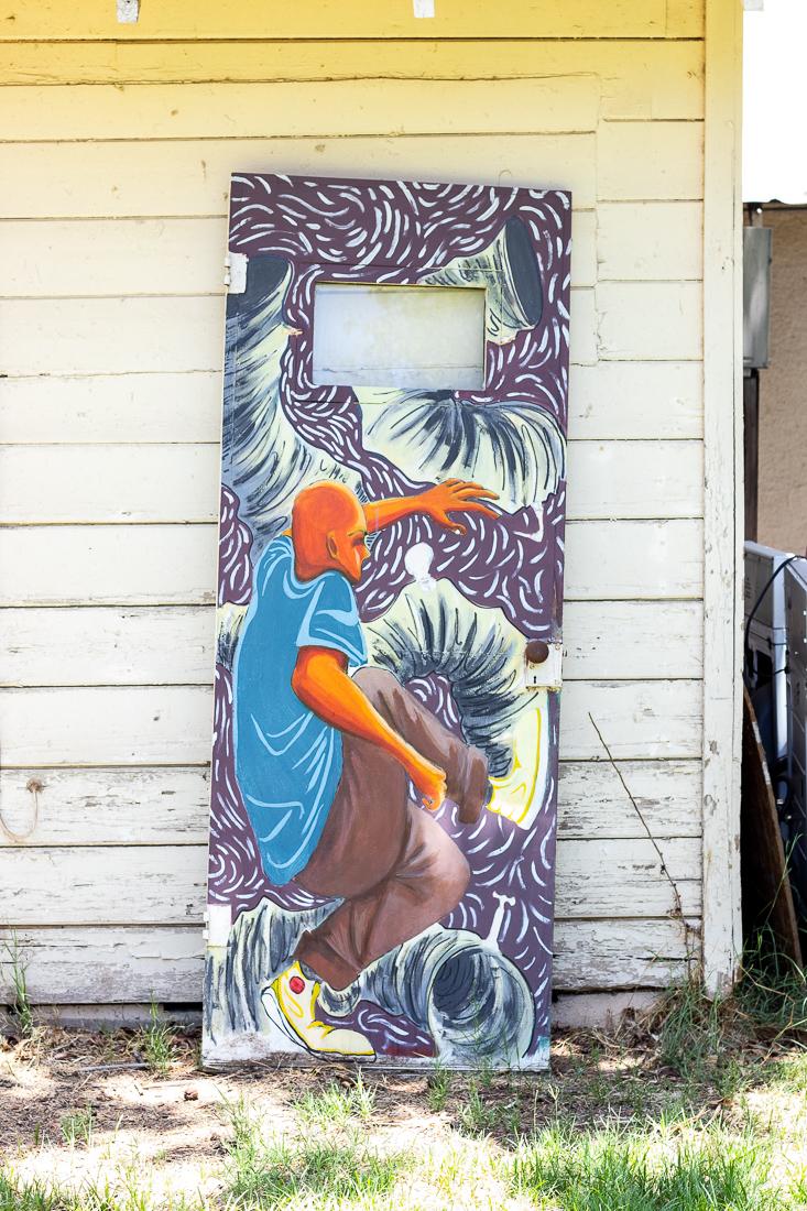 A broken door painted by Zanzucchi