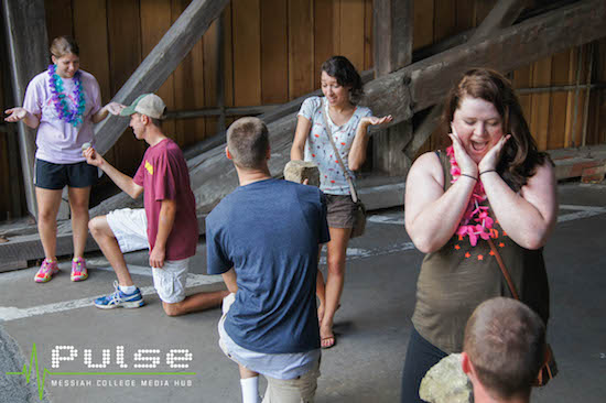 "First-year students act out three ""engagements"" by the covered bridge during last year's scavenger hunt."
