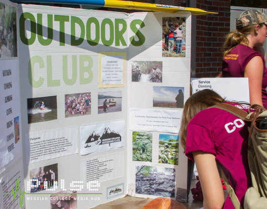 First-year students signing up for a variety of clubs and organizations, like the Outdoors Club, at the Opportunities Fair.