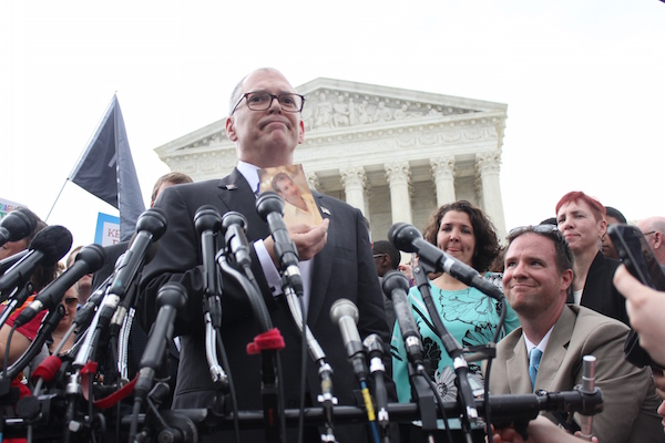 James Obergefell, the lead plaintiff in the Supreme Court case Obergefell v. Hodges holds up a photo of his deceased husband, John Arthur, on the steps of the Supreme Court after the court legalized same-sex marriage. SFHWire photo by Jaelynn Grisso