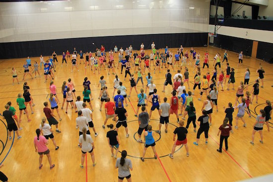 Students participate in a Zumba class in Hitchcock Arena. Photo from the Messiah Zumba Facebook page.