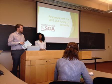 Student Body President, Jonathan Fuller, and Vice President of Diversity, Jocelyn Chavous, present the survey results. Photo taken from SGA's Facebook page.
