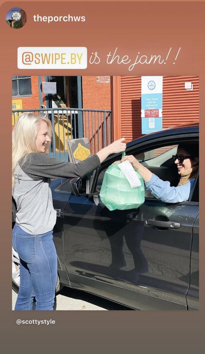 Staff handing off order to Swipeby customer in their car