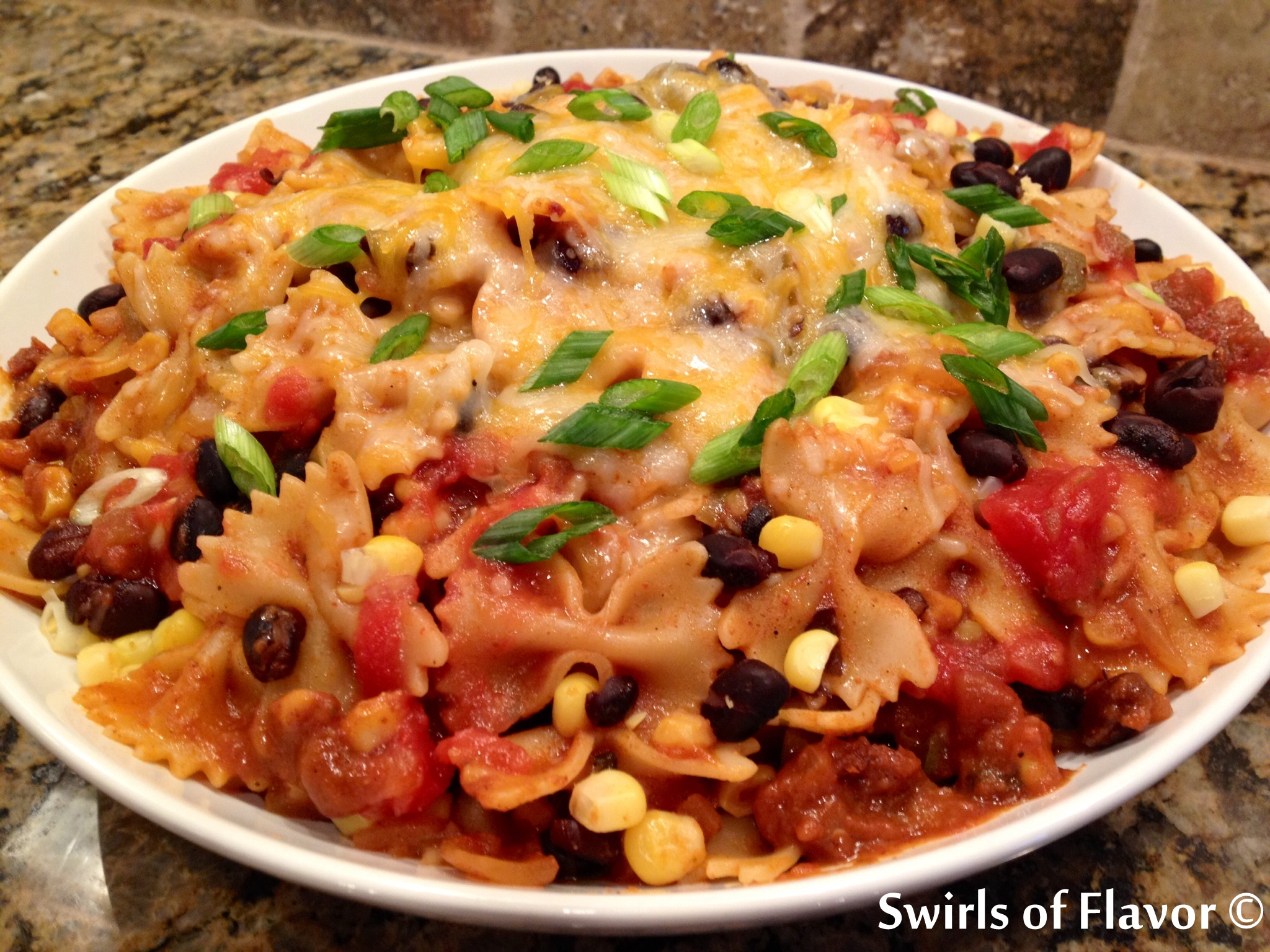 One Pot Mexicali Bowtie Pasta, an easy weeknight recipe that cooks in just minutes in one pot, is bursting with corn, black beans, pasta and cheesiness! recipe   easy   dinner   one pot   pasta   corn   black beans   mexican   #swirlsofflavor