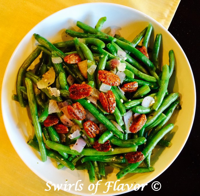 BButtery Green Beans is an easy recipe of fresh green beans sautéed with red onion and garlic, simmered in white wine, tossed with buttery goodness and crowned with glazed pecans.It's time to update your green bean casserole for Thanksgiving with this easy side dish recipe! #greenbeans #freshgreenbeans #sidedish #vegetable #sauteedgreenbeans #holiday #Thanksgiving #Christmas #Swirlsofflavor