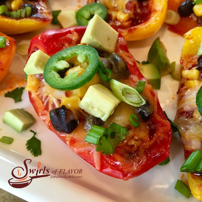 Spicy Nacho Stuffed Peppers are seasoned with taco seasoning and brimming with salsa, black beans, corn, avocado, jalapeno and cheesy goodness! #nachos #easyrecipe #appetizer #nachosrecipe #lowfat #glutenfree #cheese #stuffedpeppers #swirlsofflavor