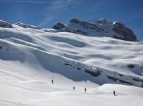 Skiers on the way down