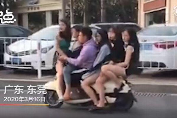 新型コロナへの警戒中、5人の女性をスクーターに乗せた男を中国警察が逮捕