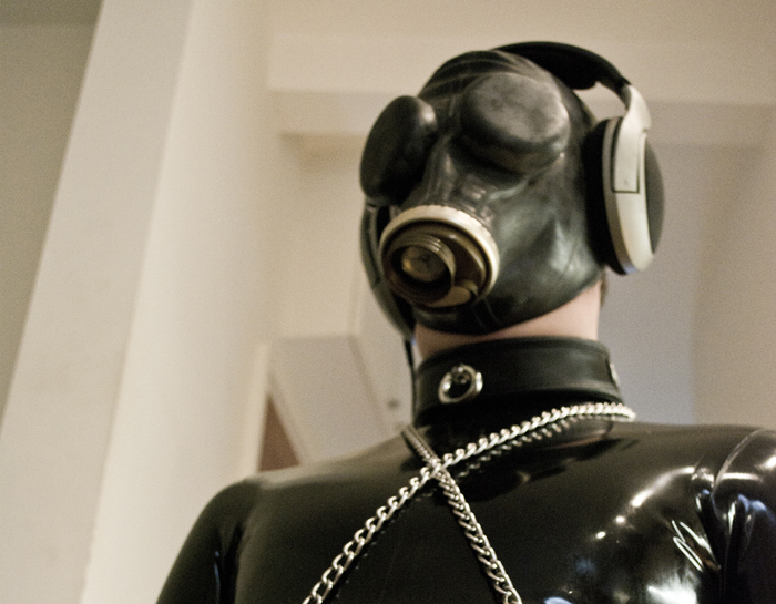 Submissive in Sensory Deprivation with White Noise and Gasmask With Covers