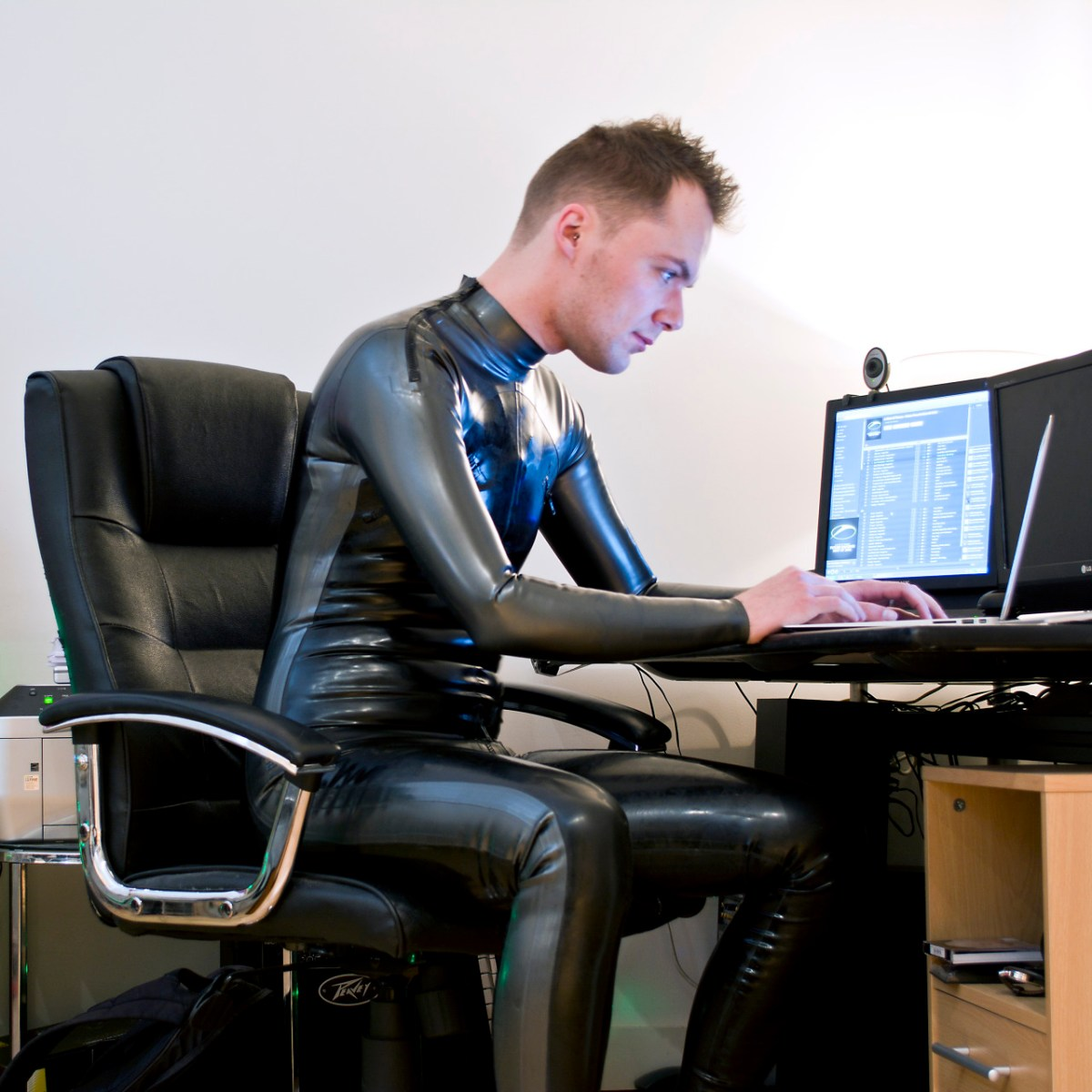Working From Home in Rubber Suit