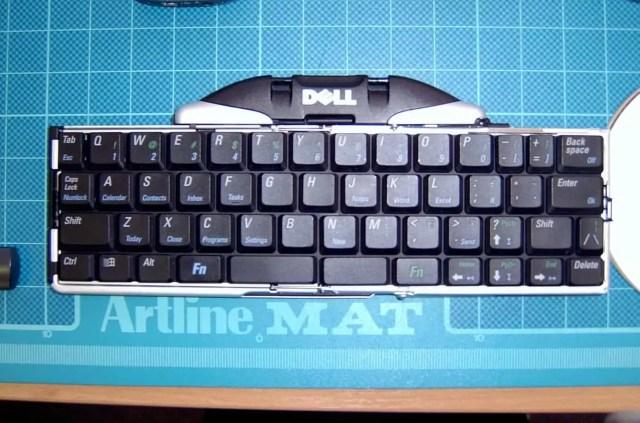 simple black keyboard on desk mat