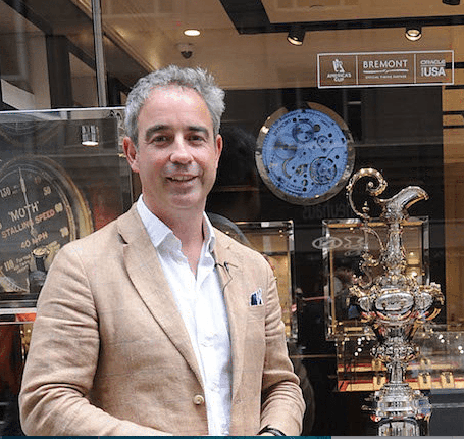 Giles stands with the America's Cup in front of Bremont's Mayfair boutique.