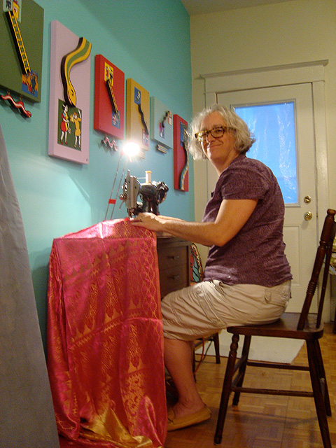 Christine sewing banners made from donated sari fabric.