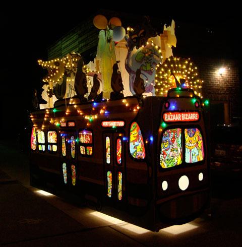 The Bazaar Bizarre Streetcar with windows glowing.