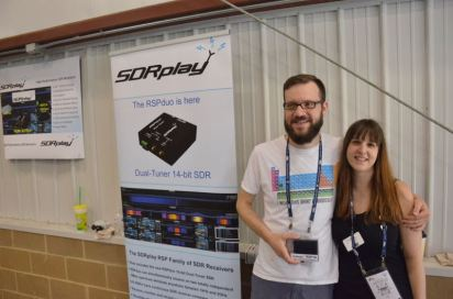 Our booth volunteers Nate and Christine purchased their first SDR and mag loop antenna!