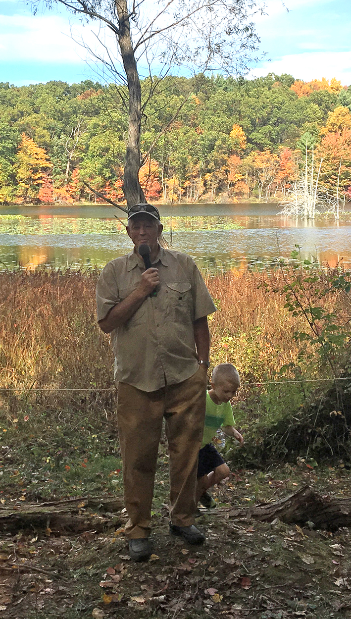 Jerry Portman (with a grandson), who formerly owned the property with his wife Julie, spoke movingly of his love of the land.