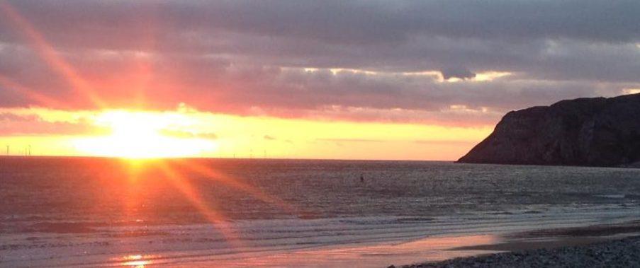 Sun rising over the Little Orme in Llandudno