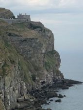 Llandudno Lighthouse perched on the edge of a cliff on the Great Orme Coastal Path in Llandudno