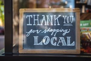Sign in shop window thanking people for going to Independent Shops