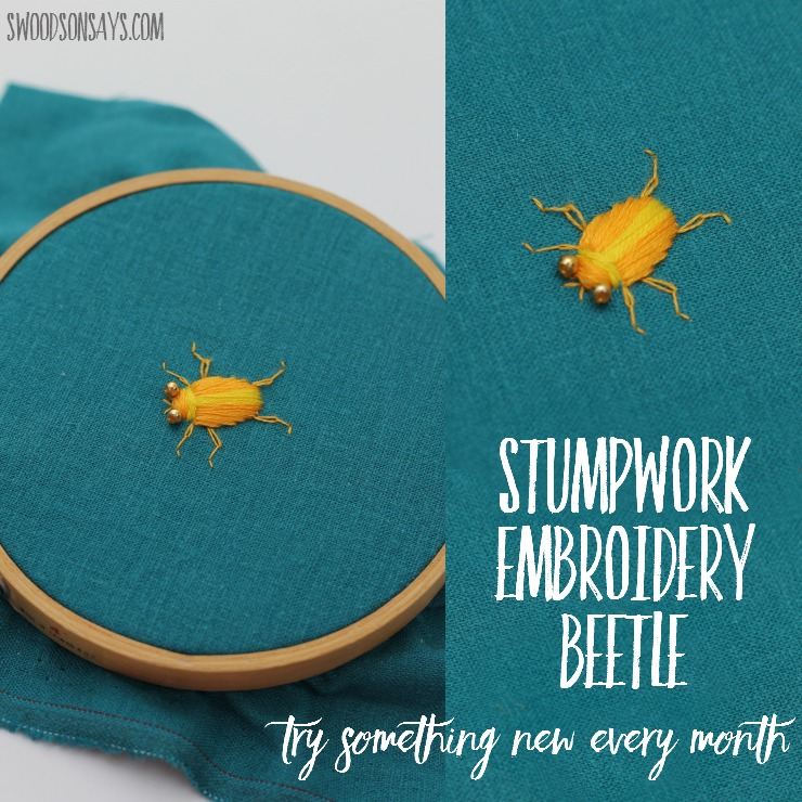 A stumpwork embroidery beetle with bead eyes.