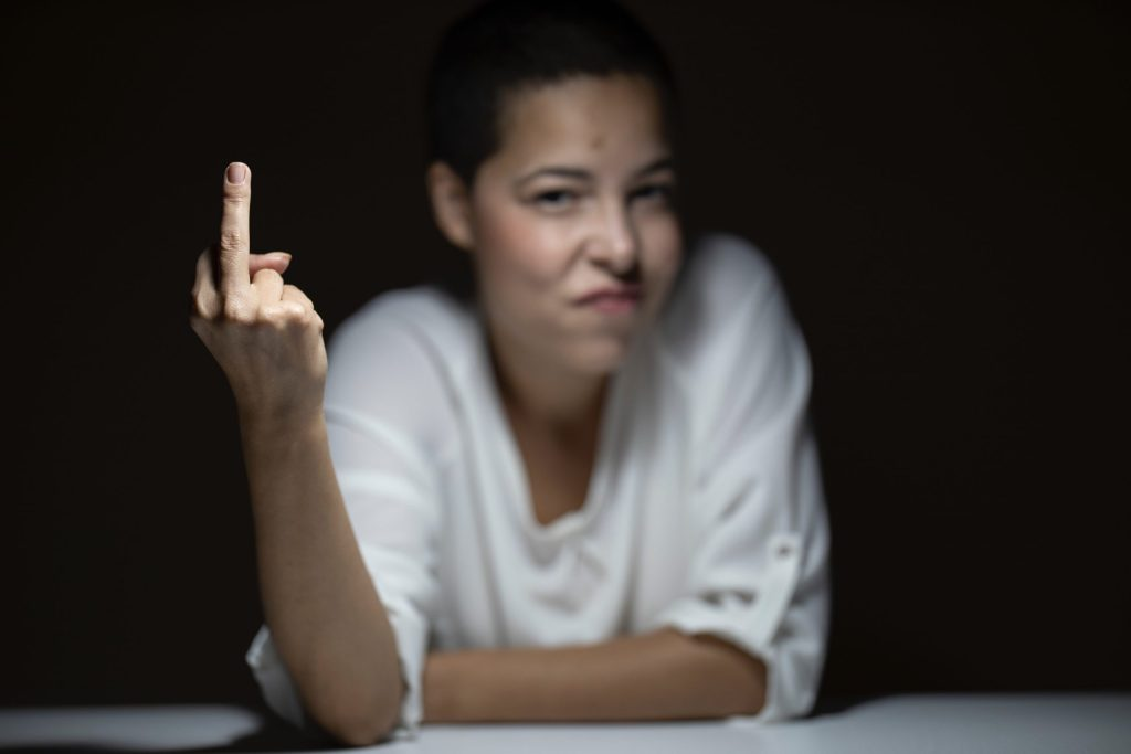 Angry woman giving the finger