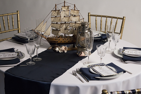 illustrates how a table runner can transform an event table into something beautiful for a relatively low cost