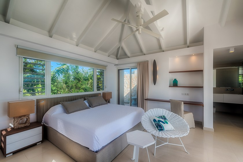 The bed in an open space room at villa turtle nest on baie longue beach