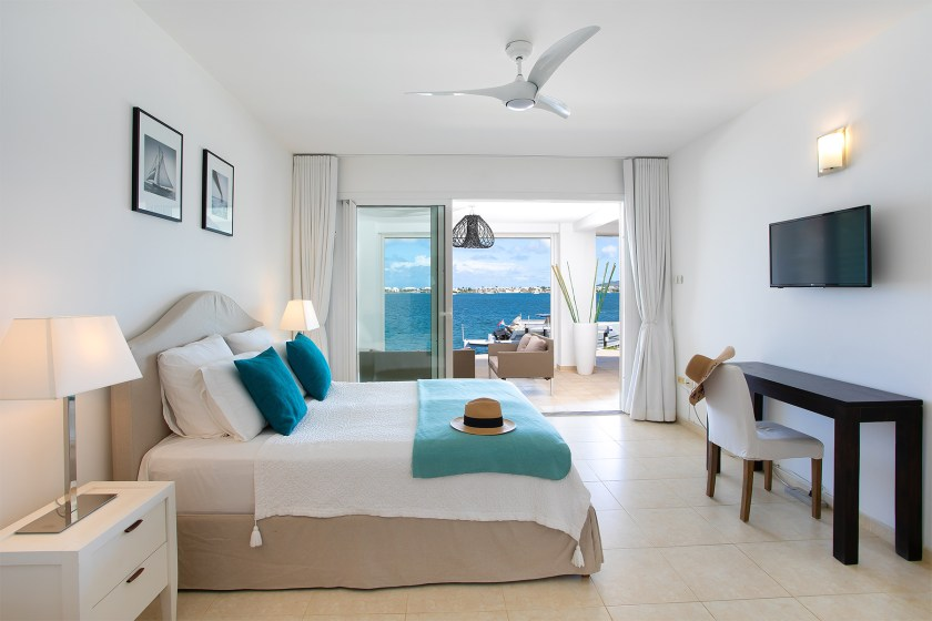 bed with blue pillows at villa allegra