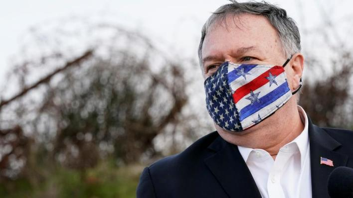 U.S. Secretary of State Mike Pompeo listens as Israeli Foreign Minister Gabi Ashkenazi speaks after a security briefing on Mount Bental in the Israeli-occupied Golan Heights November 19, 2020. Patrick Semansky/Pool via REUTERS