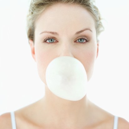 woman blowing a chewing gum bubble