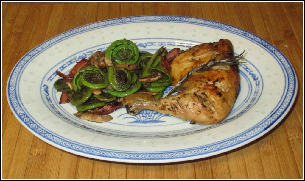 A Serving of Lemon Rosemary Chicken with Fiddleheads