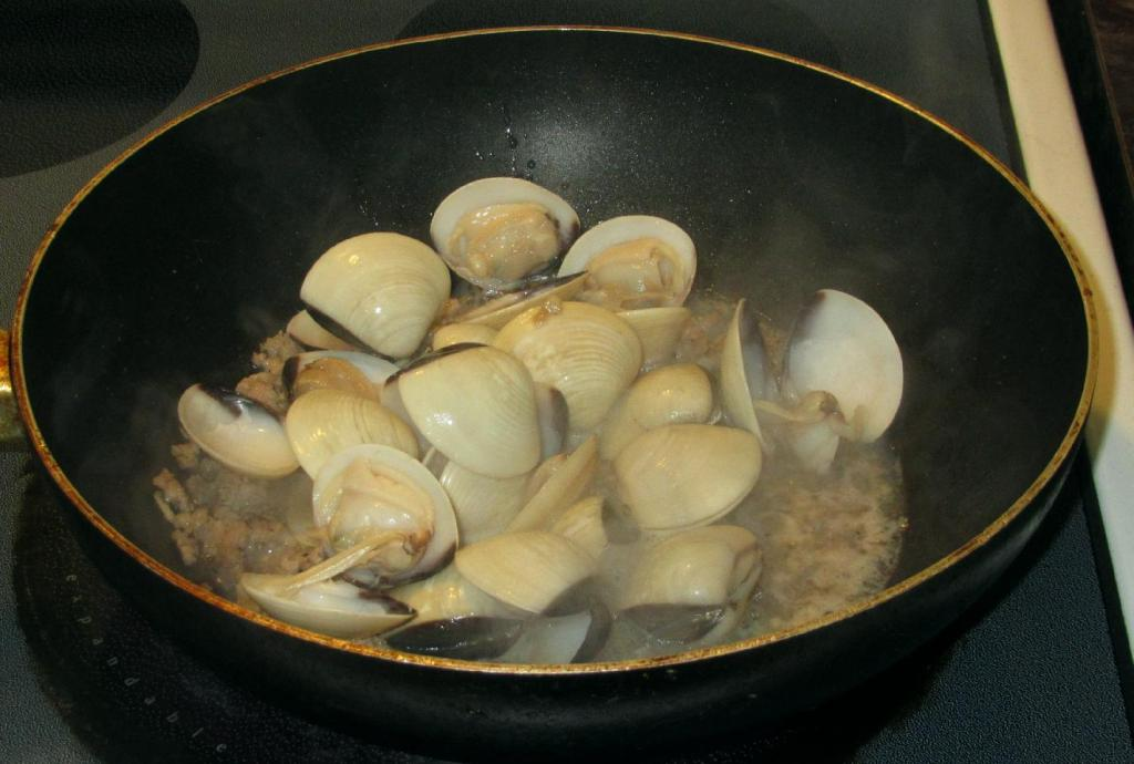 Cooking the Clams with the Pork.