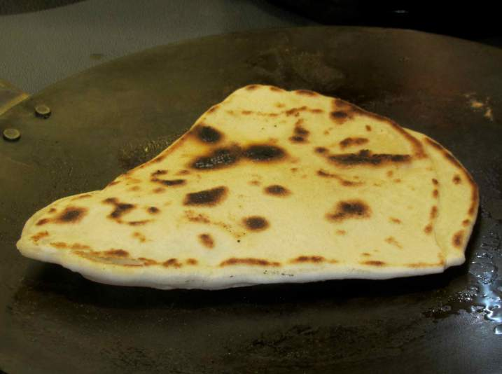 A nearly cooked Paratha