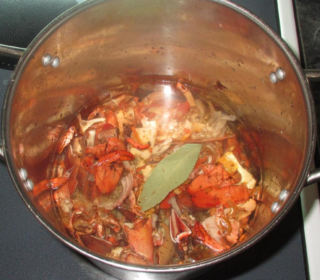 Simmering Lobster shells in the stockpot with Aromatics