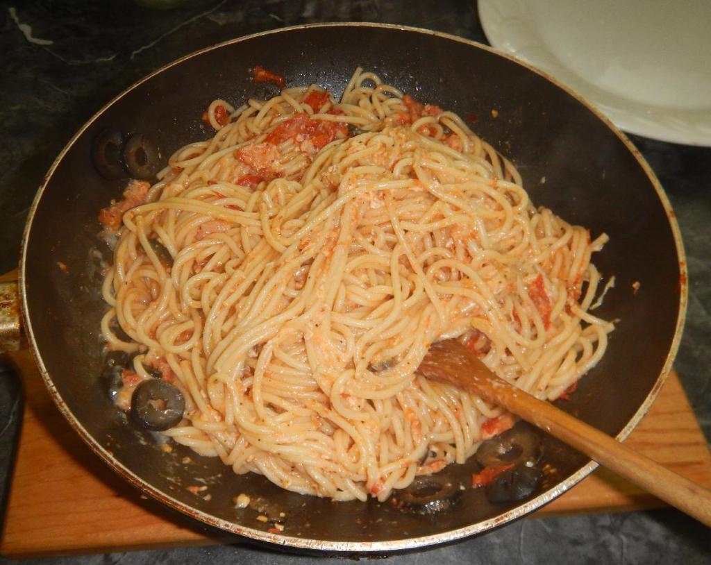 Finishing a dish of Three Grandmothers Spaghetti
