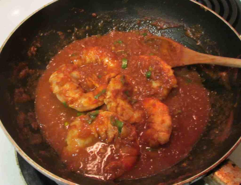 Finishing a Tiger Prawn Curry