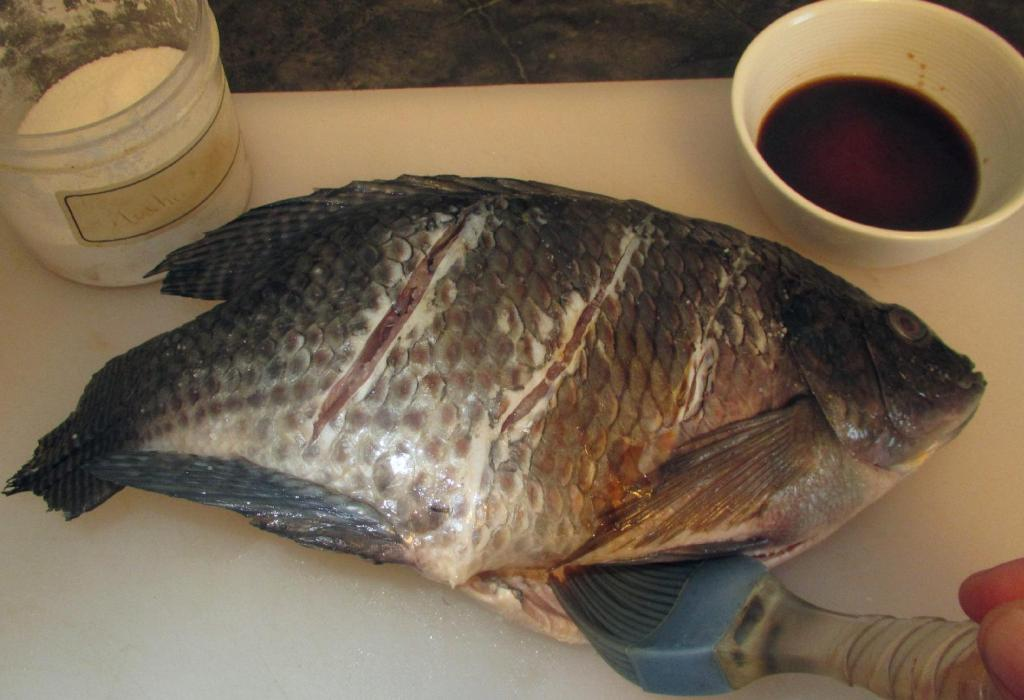 Cutting Slashes into Whole Fish for Grilling