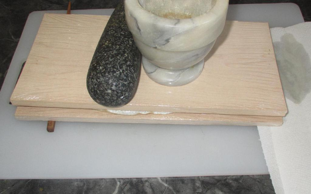 Pressing Rollmops to extract excess Pickling liquid.