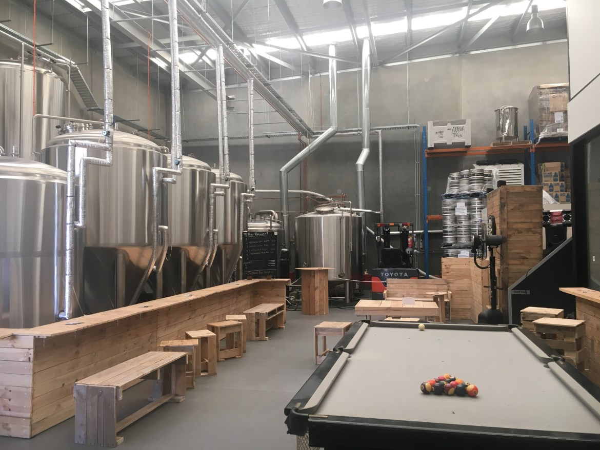 Akasha Brewing cellar door stainless steel and pool table