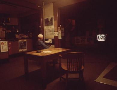 Old man watching TV