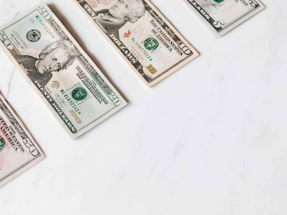set of various dollar banknotes on white table