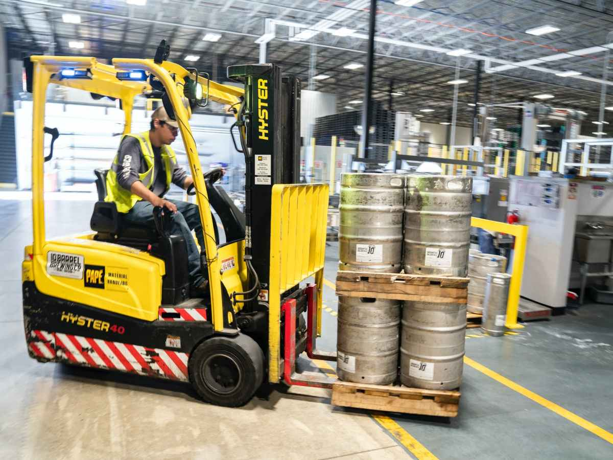 person driving yellow forklift