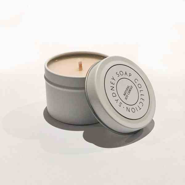 2oz candle in white travel tin and lid with cotton wick and soy wax