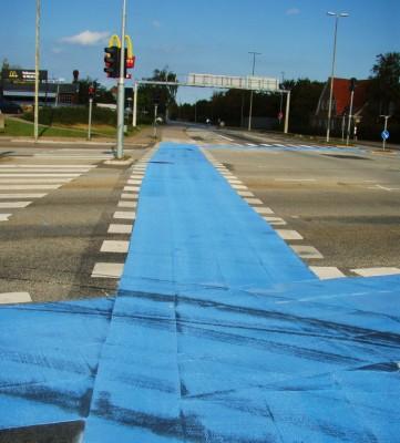 Blå løper for syklister i kryss!