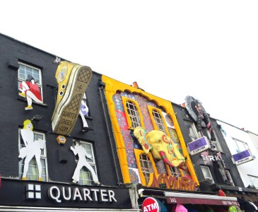 Giant trainer leaping over the shops on Camden High Street